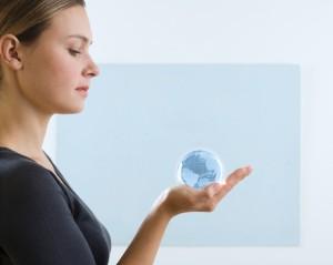 Woman holding small globe