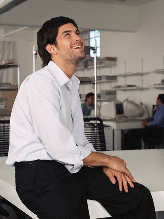 Happy office worker --- Image by © Image Source/Corbis