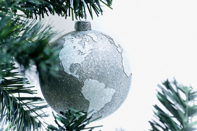 Silver globe bauble on tree
