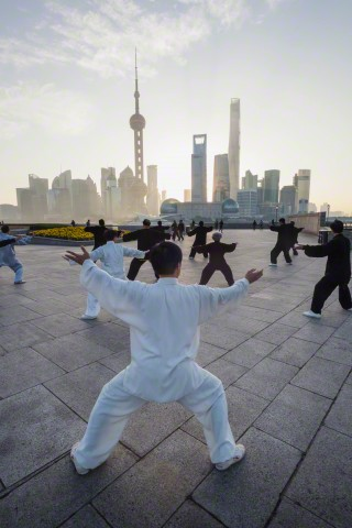 Group of People Practicing Tai chi on The Bund, Shanghai